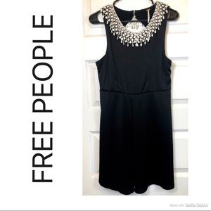 Black Sleeveless Popcorn Dress with Cut out Back